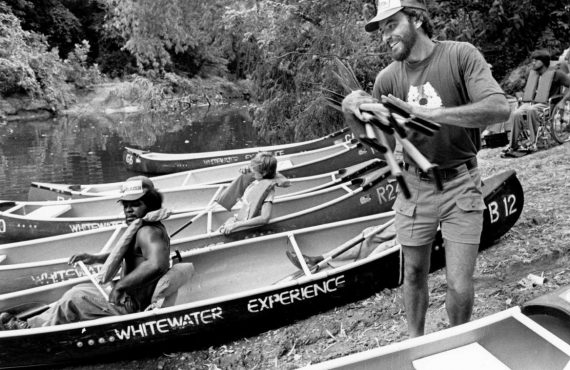 Don Greene in front of canoe