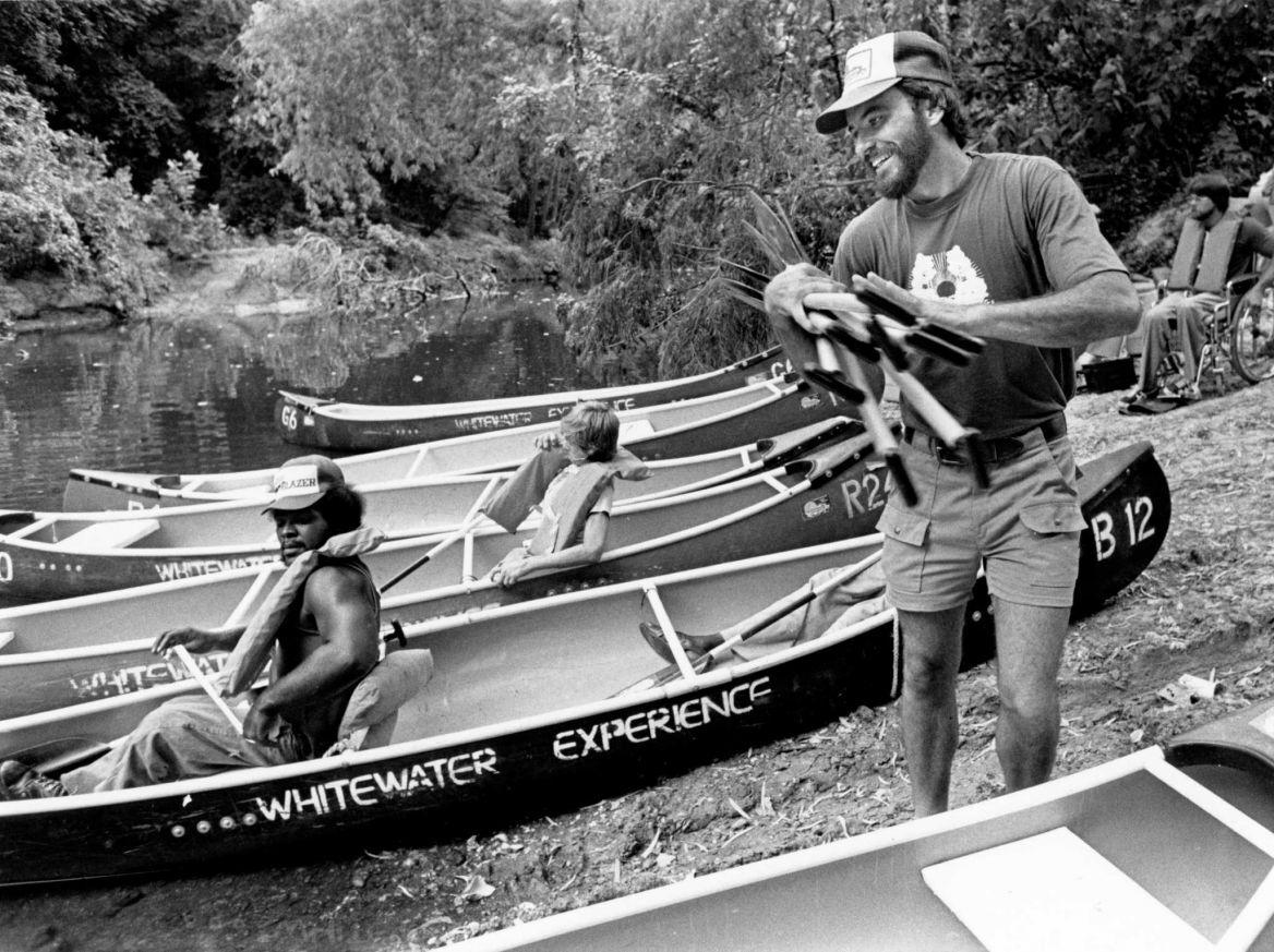 Don Greene in front of canoe